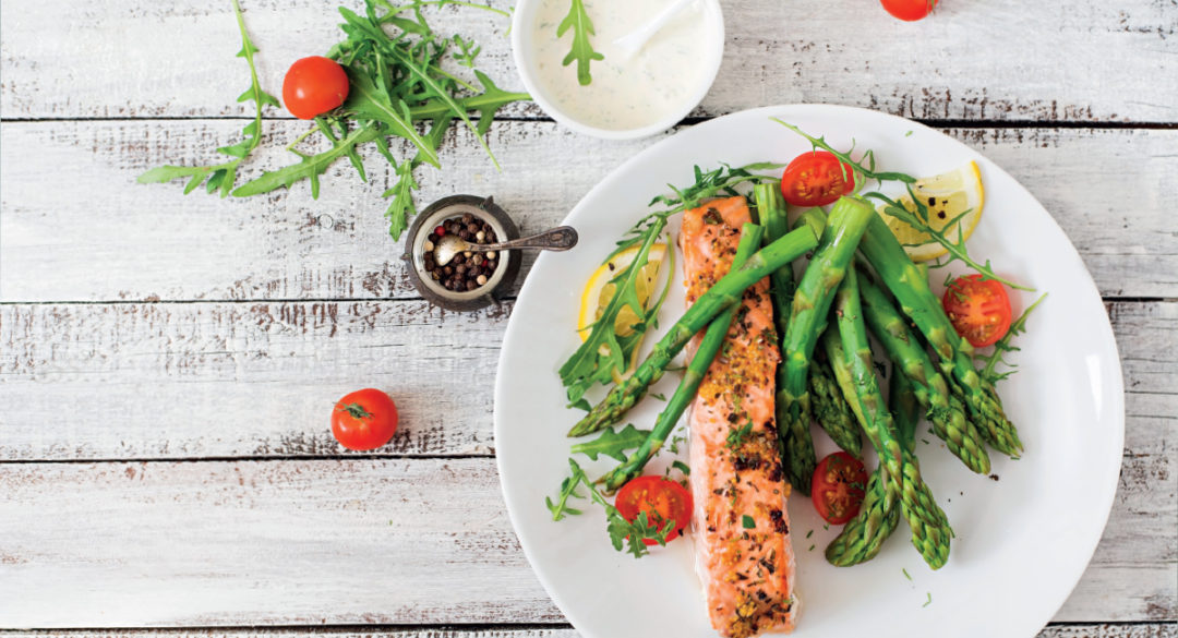 Salmon, Asparagus and Cherry Tomatoes on White Plate