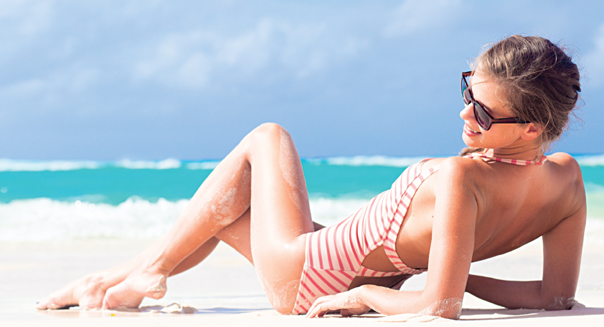 Woman Reclining on Sandy Beach
