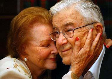 Elderly Couple Embrace