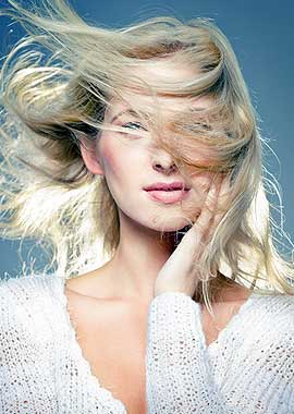 Girl with Beautiful wind-swept blonde hair