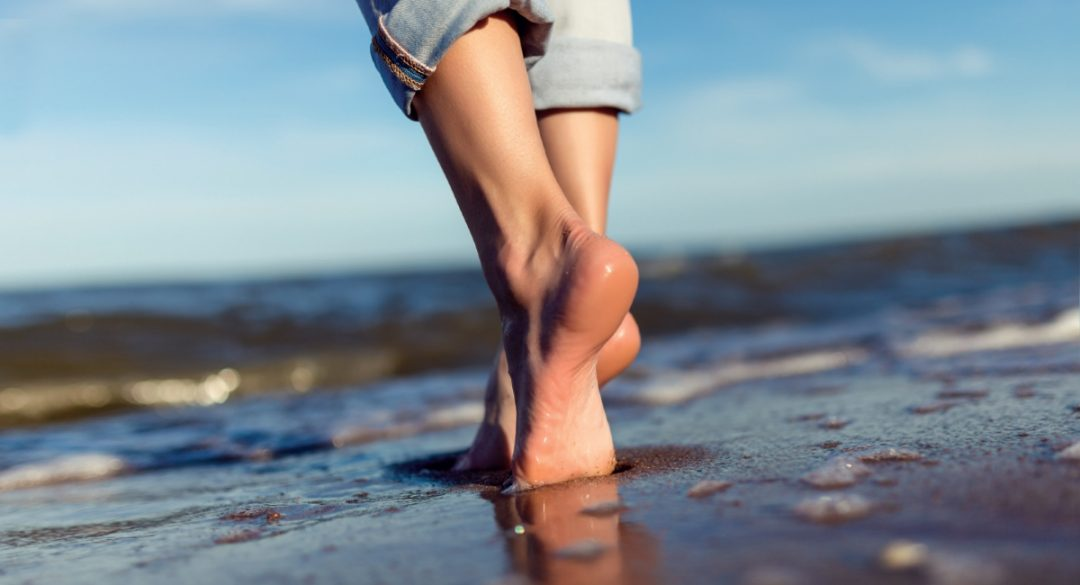 Barefoot Along the Beach Shoreline