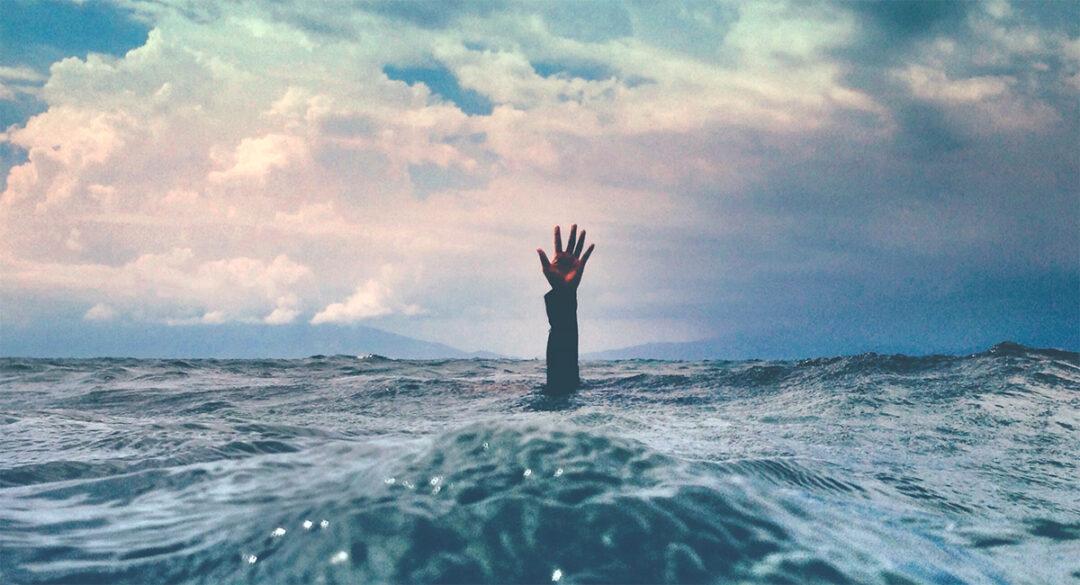 Hand Emerging from Ocean
