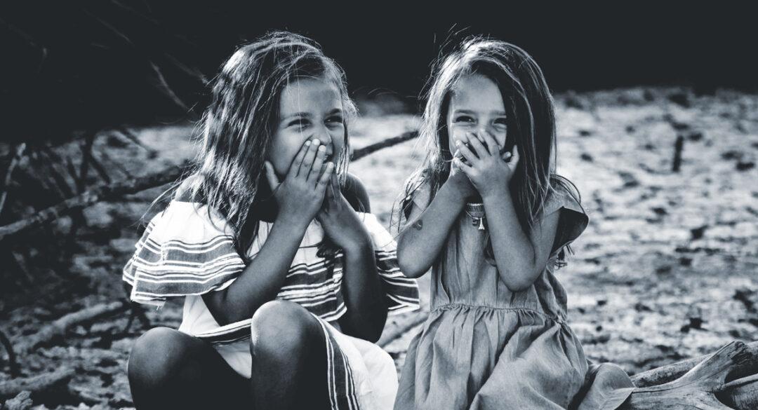 Laughing Girls Sitting Down