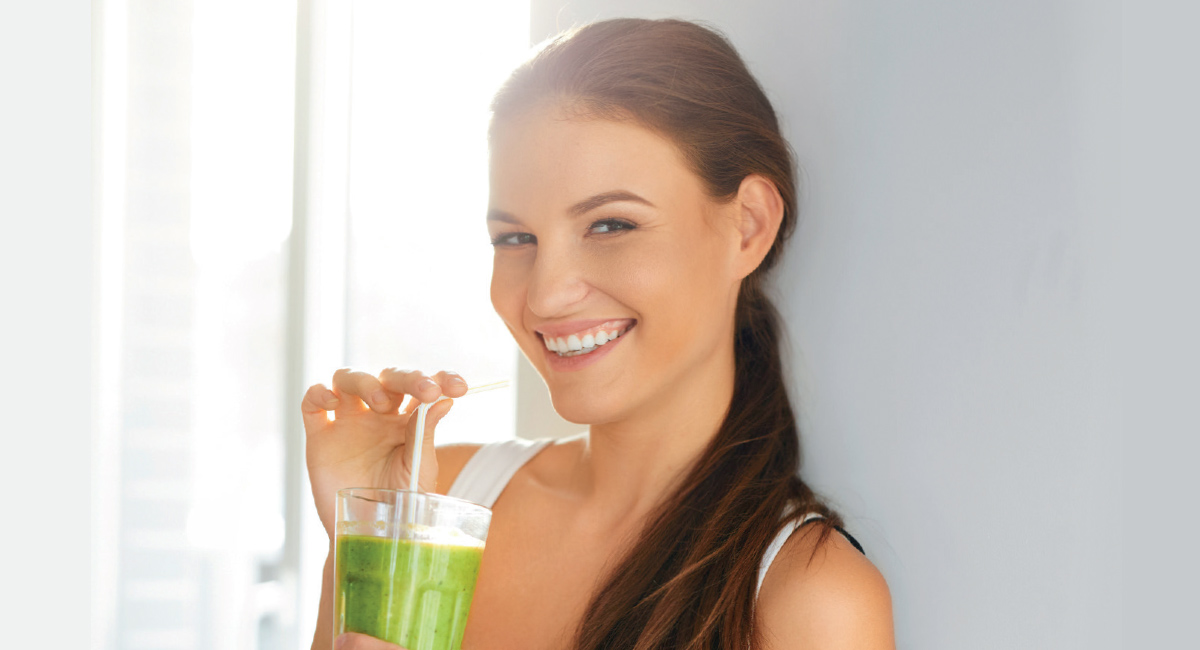 Smiling Woman with Green Juice