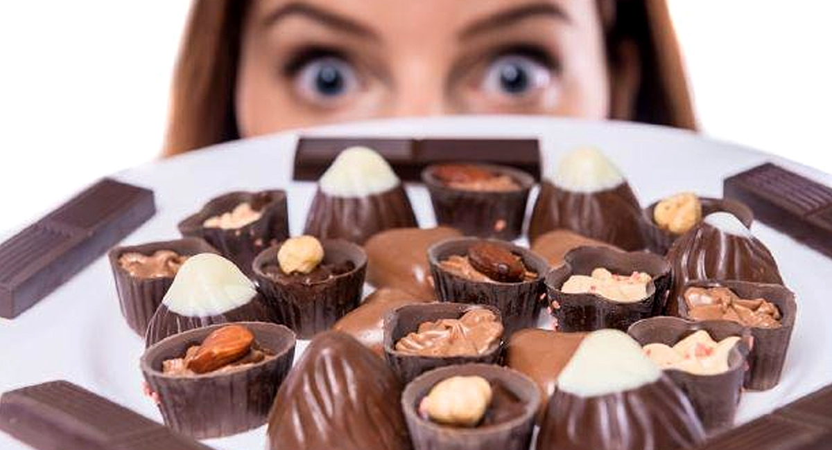 Woman Looking at Plate of Chocolate