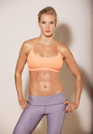 Beautiful woman with fit, sweaty body